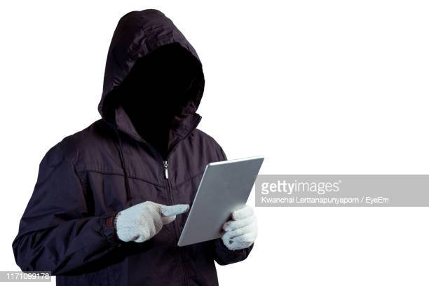 hacker using digital tablet against white background - identity theft stock pictures, royalty-free photos & images