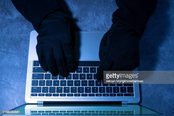 hacker using laptop. hacking the internet. - phishing stock pictures, royalty-free photos & images