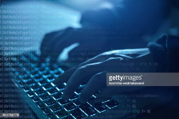 hacker using laptop. lots of digits on the computer screen. - scammer stock pictures, royalty-free photos & images
