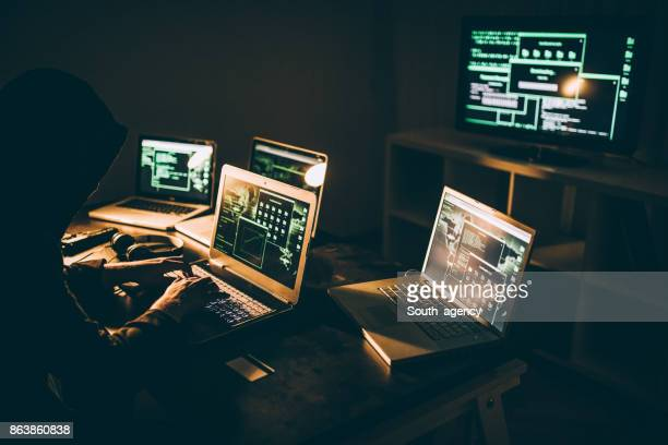 hacker using laptop - threats stock pictures, royalty-free photos & images