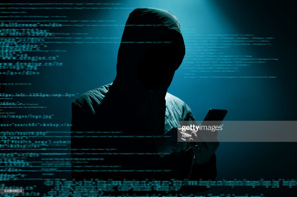 Hacker using phone : Stock Photo