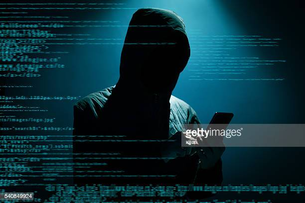 hacker using phone - criminal stock pictures, royalty-free photos & images