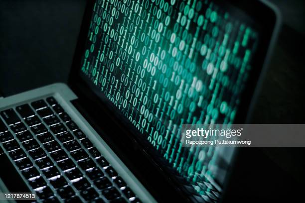 hacker with binary codes on monitor - identity theft stock pictures, royalty-free photos & images