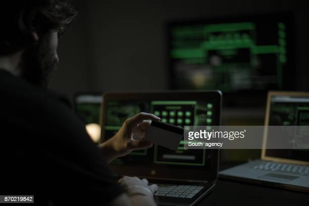 hacker with credit card - dark web stock pictures, royalty-free photos & images