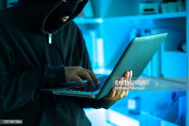 hacker with laptop, concept - pirate criminal stock pictures, royalty-free photos & images