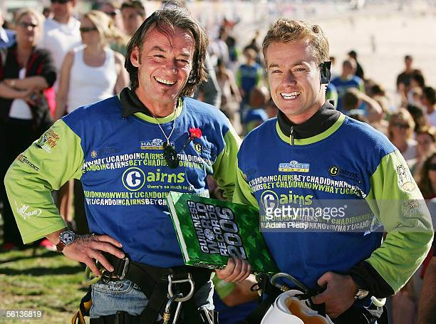 Hackett and Grant Denyer celebrate after bungy jumping out of a helicopter at Bondi Beach November 11 2005 in Sydney Australia The pair set a...