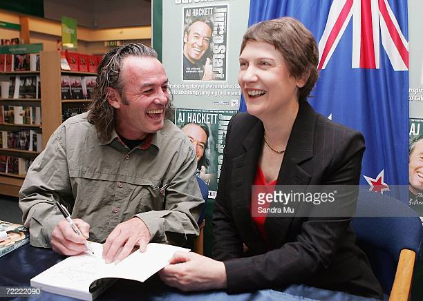 AJ Hackett signs an autograph for New Zealand Prime Minister Helen Clark during the launch of the AJ Hackett's autobiography Jump Start at the...