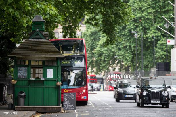 Hackney Carriage taxi drives past the Grosvenor Gardens Cabmen's Shelter on July 27 2017 in London England The Cabmen's Shelters were established in...