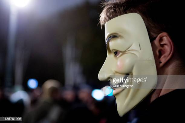 Hacktivist Collective Anonymous outside the Conservative Party Campaign Headquarters in Westminster during their Annual Million Mask March around...