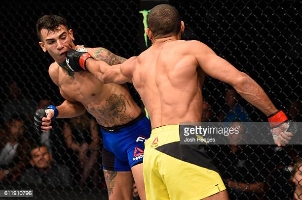 Hacran Dias of Brazil punches Andre Fili in their featherweight bout during the UFC Fight Night event at the Moda Center on October 1 2016 in...