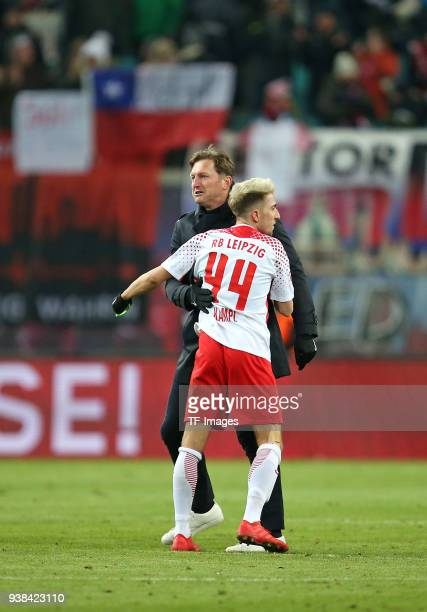 Had coach Ralph Hasenhuettl of Leipzig and Kevin Kampl of Leipzig celebrates after winning during the Bundesliga match between RB Leipzig and FC...