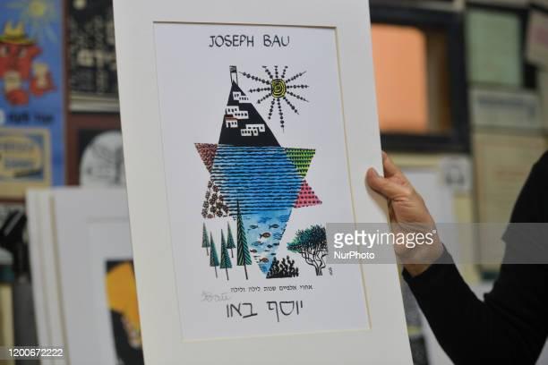 Hadasa Bau holds her father's painting 'Star of David' inside 'Joseph Bau house' Museum in Tel Aviv. Joseph Bau was a Polish-Israeli artist,...