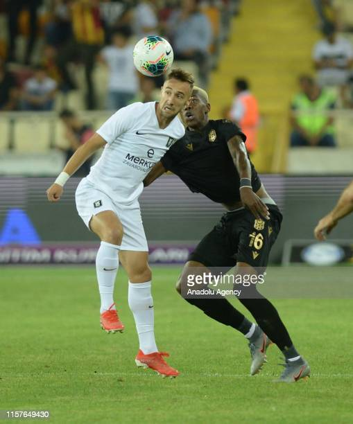 Hadebe of Yeni Malatyaspor in action against Cekici of Olimpija Ljubljana during the UEFA Europa League second qualifying match between Yeni...
