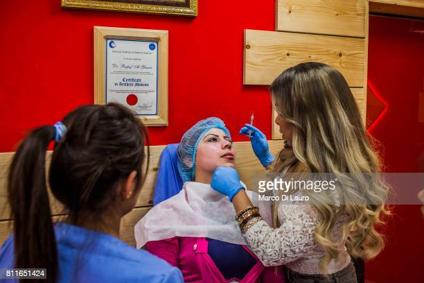 April 20: Hadeel al-Mashhadani, 23-years-old is seen as she is under a lips augmentation treatment administer by Doctor Rafeef al-Yazerie at the...