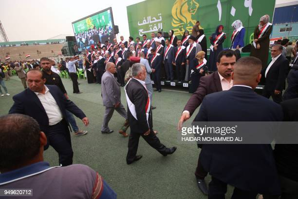 Hadi alAmeri head of the Badr organisation and leader of the mostly Shiite Hashed alShaabi paramilitary units arrives to attend a campaign gathering...