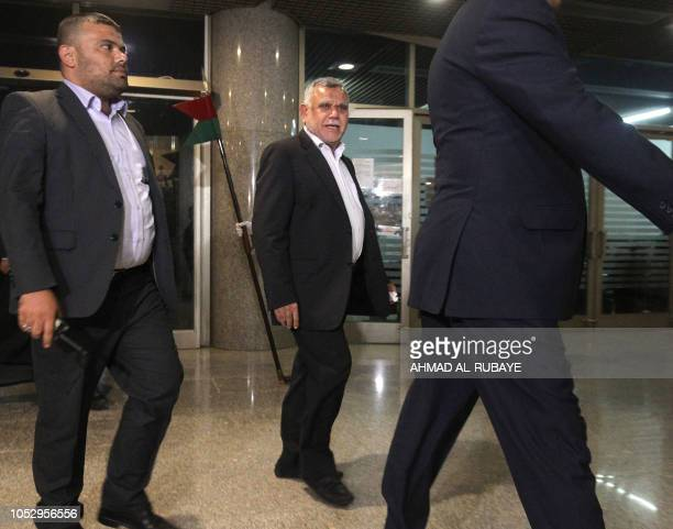 Hadi alAmiri head of the Fatah list arrives at parliament headquarters in the capital Baghdad on October 24 prior to a vote on the new proposed...