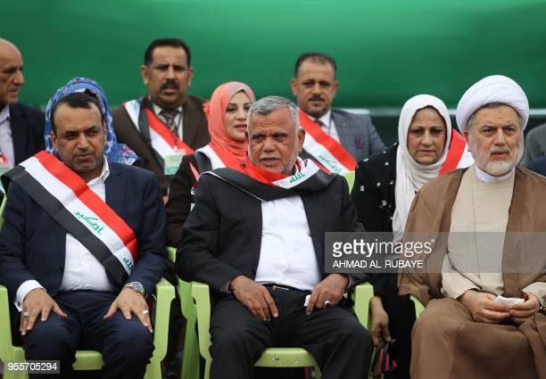 Hadi alAmiri head of the Iranianbacked Badr Organization and leader of the Fateh Alliance a coalition of Iraniansupported militia groups attend a...