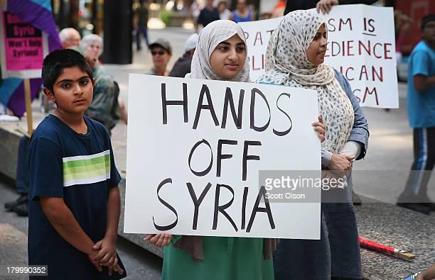 Hadi Khamsi , Muhadisa Raza and Uzma Rizvi join a protest against U.S. Intervention in Syria on September 7, 2013 in Chicago, Illinois. President...