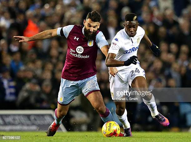 Hadi Sacko of Leeds United and Mile Jedinak of Aston Villa compete for the ball during the Sky Bet Championship match between Leeds United v Aston...