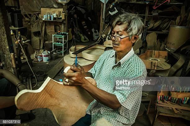 Hadi Waluyo check mahagony wood when making guitar in Zianturi Guitar Equipments Paingan Yogyakarta Indonesia on May 11 2016 Hadi Waluyo establish...