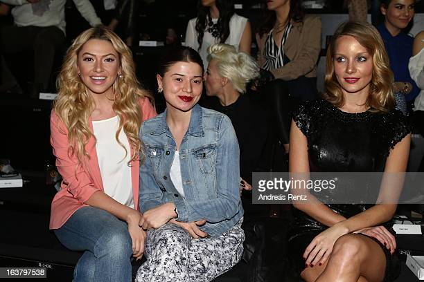 Hadise her sister and Bade Iscil attend the Soul By Ozgur Masur show during Mercedes Benz Fashion Week Istanbul Fall/Winter 2013/14 at Antrepo 3 on...