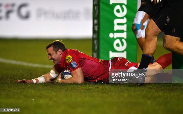 Hadleigh Parkes of Scarlets dives over to score his side's third try during the European Rugby Champions Cup match between Bath Rugby and Scarlets at...