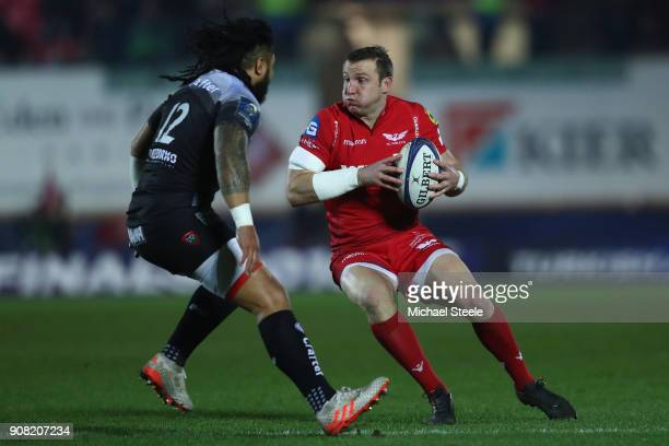 Hadleigh Parkes of Scarlets is tracked by Ma'a Nonu of Toulon during the European Rugby Champions Cup match between Scarlets and RC Toulon at Parc y...