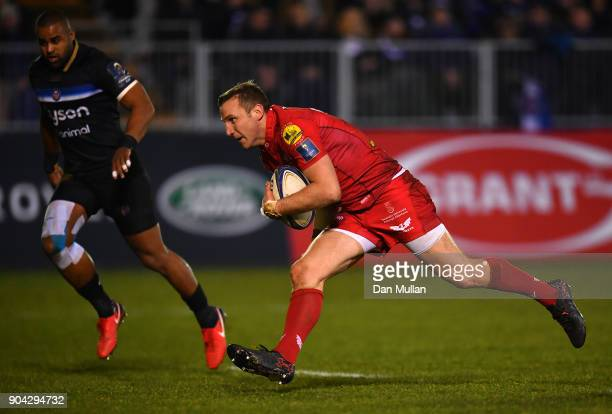 Hadleigh Parkes of Scarlets runs in to score his side's third try during the European Rugby Champions Cup match between Bath Rugby and Scarlets at...