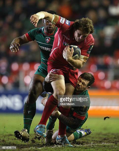Hadleigh Parkes of Scarlets tries to break through the Leicester Tigers defence during the European Rugby Champions Cup Group 3 match between...