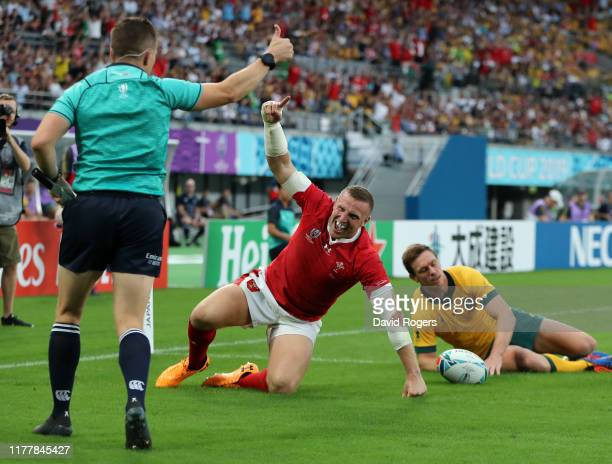Hadleigh Parkes of Wales celebrates after scoring their firs try during the Rugby World Cup 2019 Group D game between Australia and Wales at Tokyo...