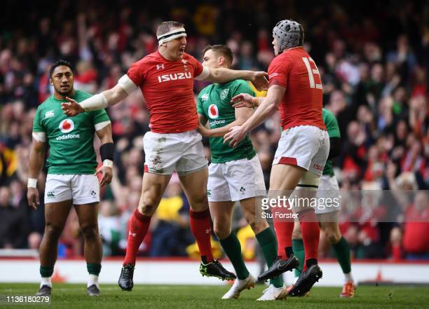 Hadleigh Parkes of Wales celebrates scoring his sides first try with Jonathan Davies of Wales during the Guinness Six Nations match between Wales and...
