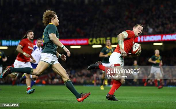 Hadleigh Parkes of Wales crosses for the third try during the international match match between Wales and South Africa at Principality Stadium on...