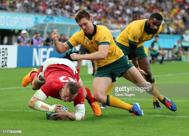 Hadleigh Parkes of Wales dives over to score their first try despite being held by Dane HaylettPetty during the Rugby World Cup 2019 Group D game...