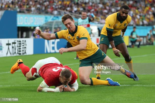 Hadleigh Parkes of Wales dives over to score their first try despite the challenge by Dane HaylettPetty during the Rugby World Cup 2019 Group D game...