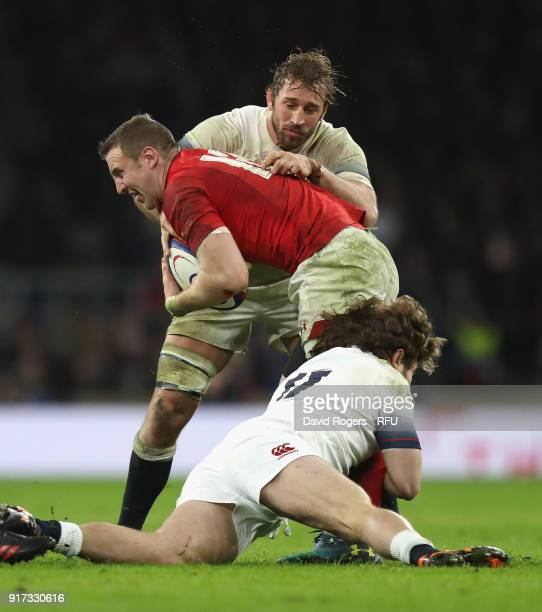 Hadleigh Parkes of Wales is tackled by Chris Robshaw and Alec Hepburn during the NatWest Six Nations match between England and Wales at Twickenham...