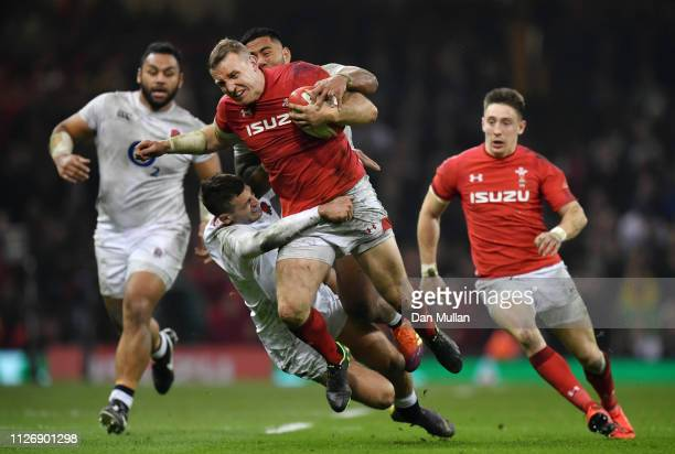 Hadleigh Parkes of Wales is tackled by Manu Tuilagi and Jonny May of England during the Guinness Six Nations match between Wales and England at...