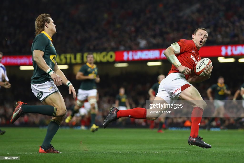 Hadleigh Parkes of Wales looks back towards Andries Coetzee of South Africa as he scores his sides third try during the International match between Wales and South Africa at Principality Stadium on December 2, 2017 in Cardiff, Wales.