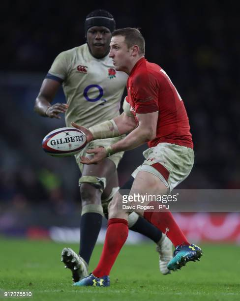 Hadleigh Parkes of Wales passes the ball watched by Maro Itoje during the NatWest Six Nations match between England and Wales at Twickenham Stadium...
