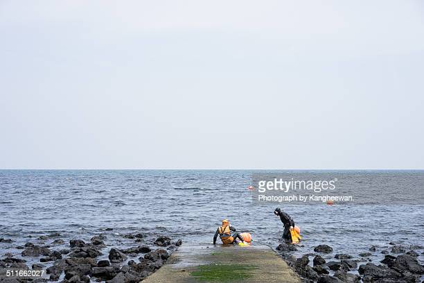 haenyeo, female diver - jeju stock photos and pictures