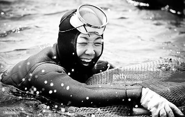A Haenyeo is all smiles as she paddles to shore at the 5th Haenyeo Diving Festival in Jeju Island South Korea