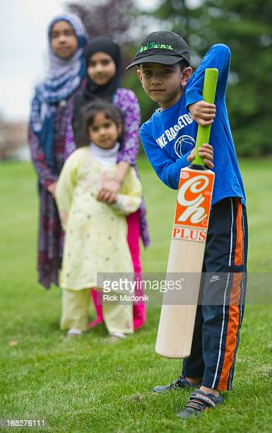 120508 BRAMPTON ONTARIO Hafiz Asim Ali's children Abdul Rahman with the cricket bat and daughters Zainab Iman 8 and Noor in a park near their home...