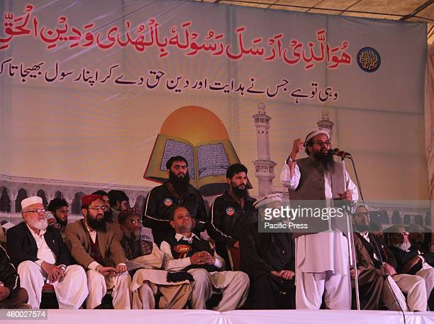 Hafiz Muhammad Saeed head of the banned Islamic charity JamatudDawa addresses to supporters during the twoday convention in Lahore According to media...