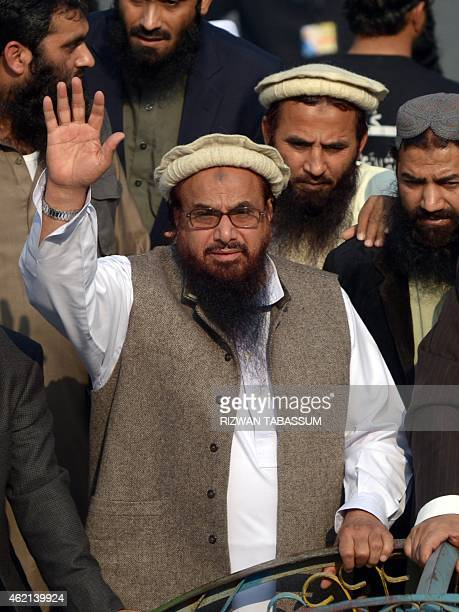 Hafiz Muhammad Saeed head of the banned Pakistan's charity organisation JamaatudDawa waves as he leads a protest rally against the printing of...