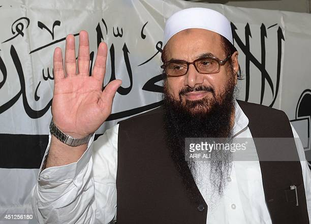 Hafiz Muhammad Saeed head of the Pakistan's charity organisation JamatudDawa gestures as he arrives for a press conference in Lahore on June 26 2014...