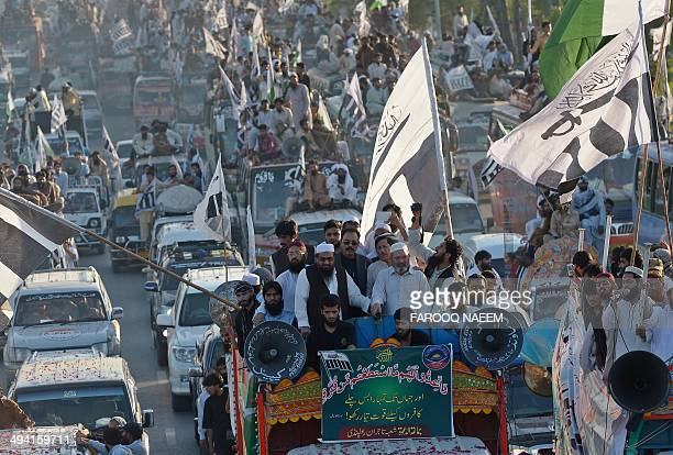 Hafiz Saeed leader of JamatudDawa waves along with others at a rally in Islamabad on May 28 on the anniversary of the country's nuclear detonation...