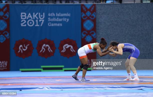 Hafize Sahin of Turkey competes against Blessing Oborududu of Nigeria during Women's Wrestling Finals within 4th Islamic Solidarity Games in Baku...