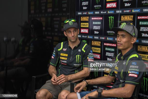 Hafizh Syahrin of Malaysia and Monster Yamaha Tech 3 and Johann Zarco of France and Monster Yamaha Tech 3 speak with journalists in paddock during...