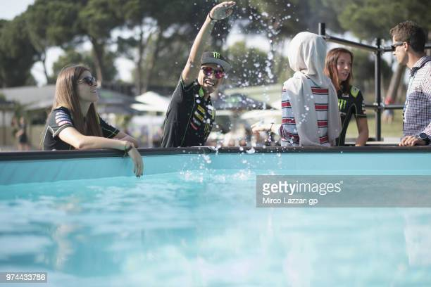 Hafizh Syahrin of Malaysia and Monster Yamaha Tech 3 jokes with water during the Monster Energy Station party during the MotoGp of Catalunya Previews...