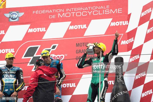 Hafizh Syahrin of Malaysia and Petronas Raceline Malaysia celebrates the third place on the podium during the Moto2 race during the MotoGP of Japan...