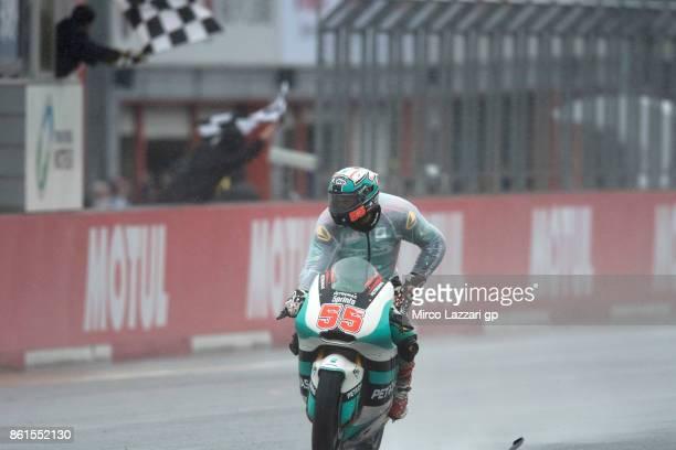 Hafizh Syahrin of Malaysia and Petronas Raceline Malaysia cuts the finish lane during the Moto2 race during the MotoGP of Japan Race at Twin Ring...